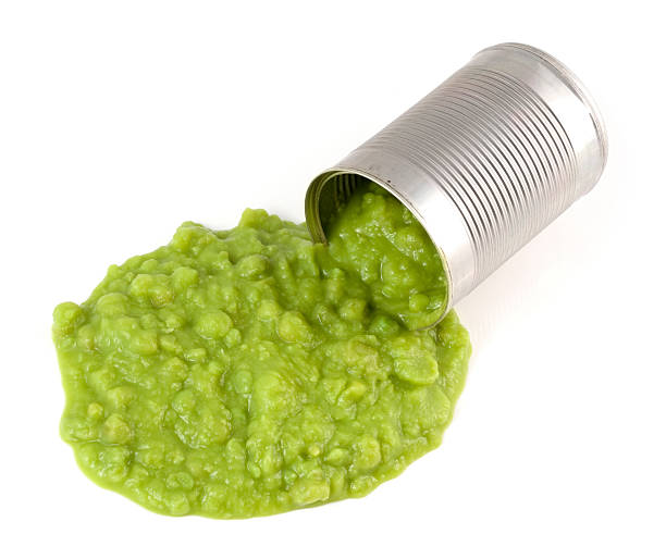 Spilt can of mushy peas stock photo