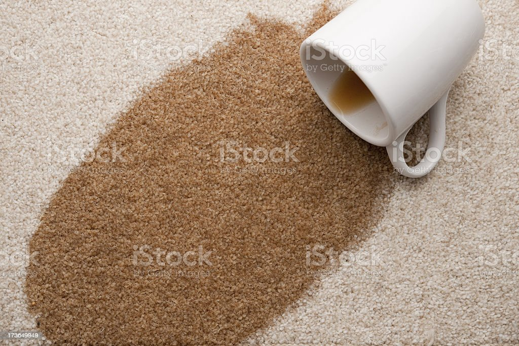 spilt coffee on the carpet royalty-free stock photo