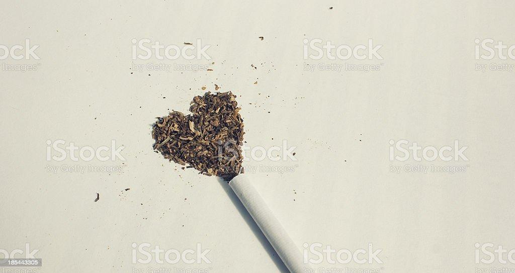 Spilt tobacco making a heart shape stock photo