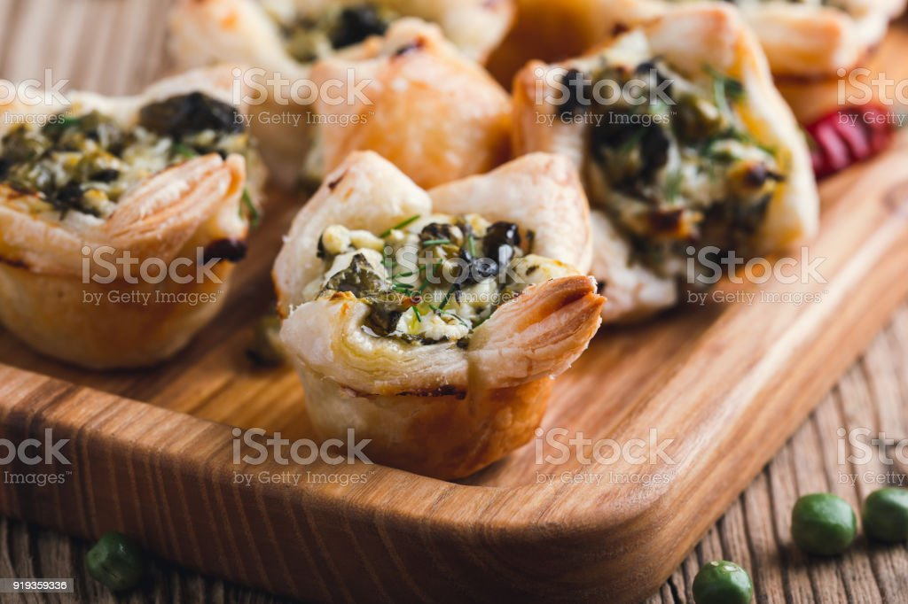 Spinach and feta cheese puff pastry cups stock photo