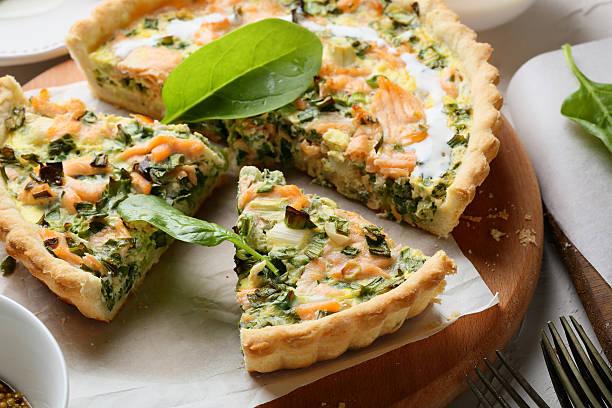 spinach and fish quiche stock photo