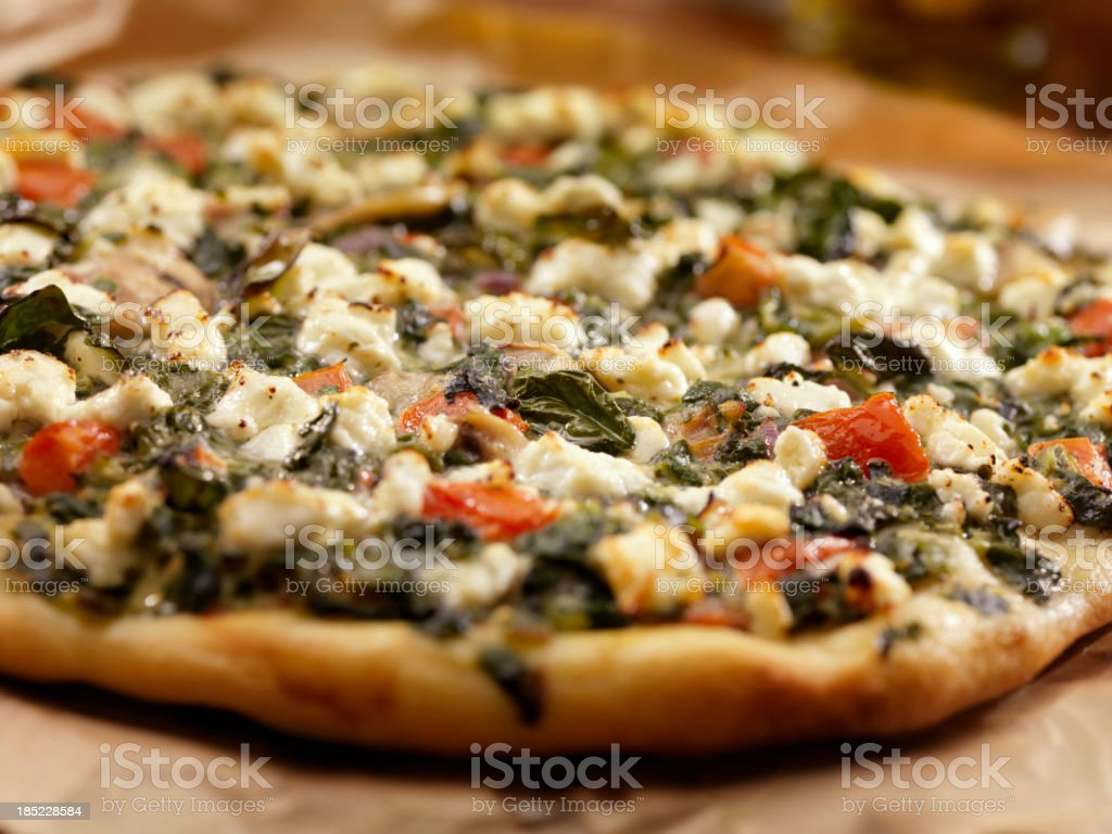 Spinach and Goat Cheese Pizza royalty-free stock photo