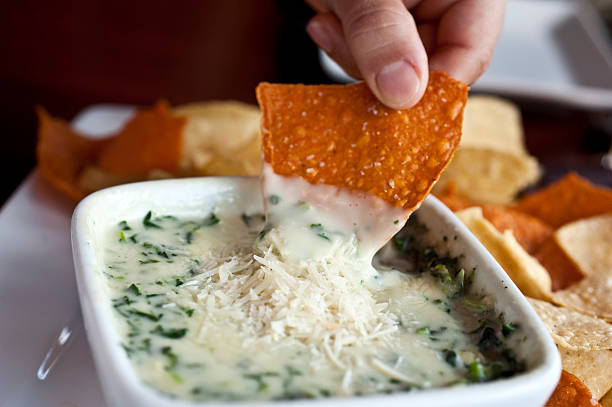 Spinach and parmesan cheese dip Spinach and parmesan cheese dip with tortilla chips dipping sauce stock pictures, royalty-free photos & images