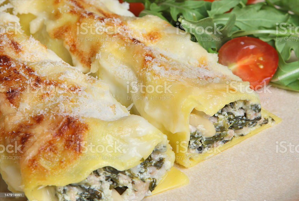 Spinach and pork cannelloni Italian dish stock photo