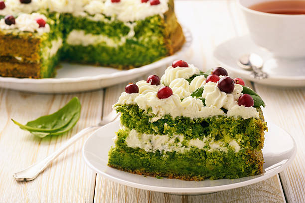 Spinach cake with cream and cranberries. stock photo