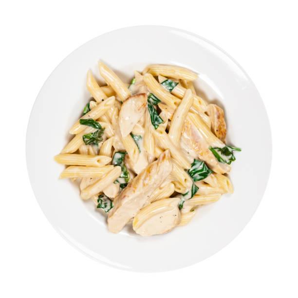 chicken alfredo parmesan pasta spinat - gesunde huhn pasta stock-fotos und bilder