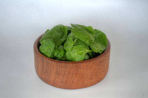 Spinach in Natural Wood Bowl stock photo