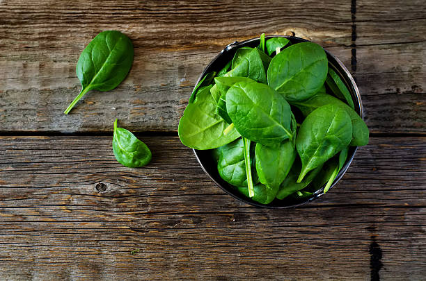 spinach in the bowl stock photo