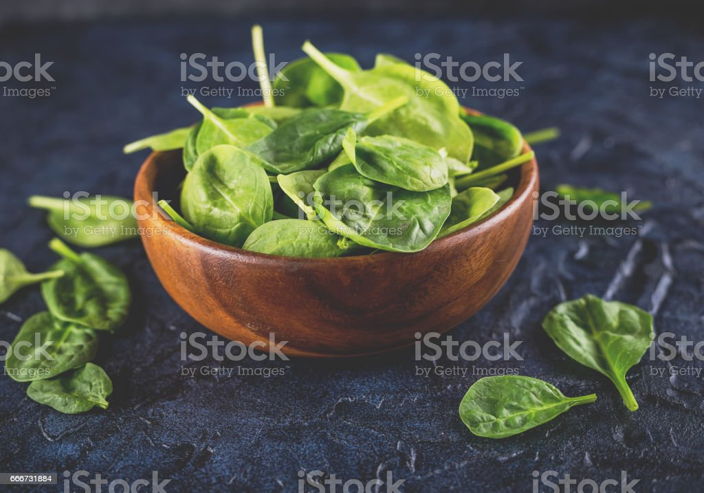 Spinach leaves in bowl stock photo