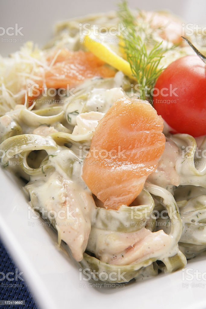 Spinach pasta with salmon royalty-free stock photo