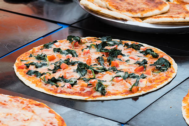 spinach pizza Koh Phangan's walking street market, street food pastry dough stock pictures, royalty-free photos & images