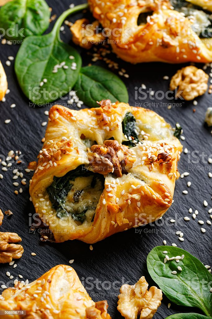 Spinach puff with addition of Gorgonzola cheese and nuts stock photo