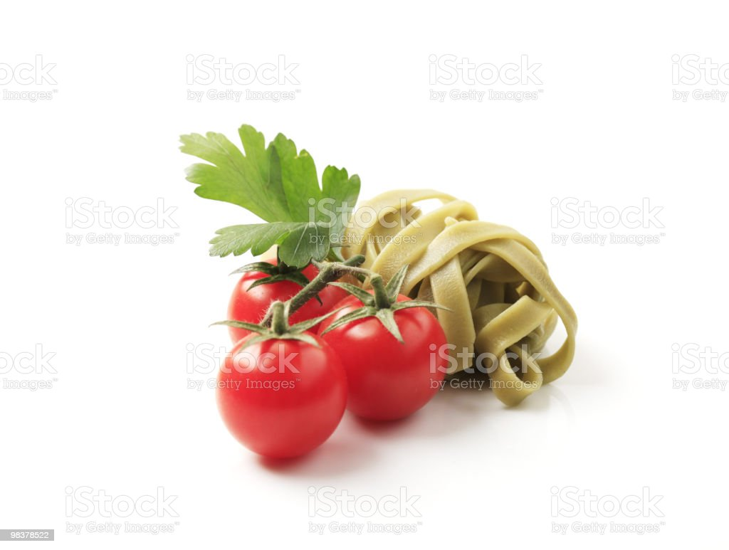 Spinach ribbon pasta and tomatoes royalty-free stock photo