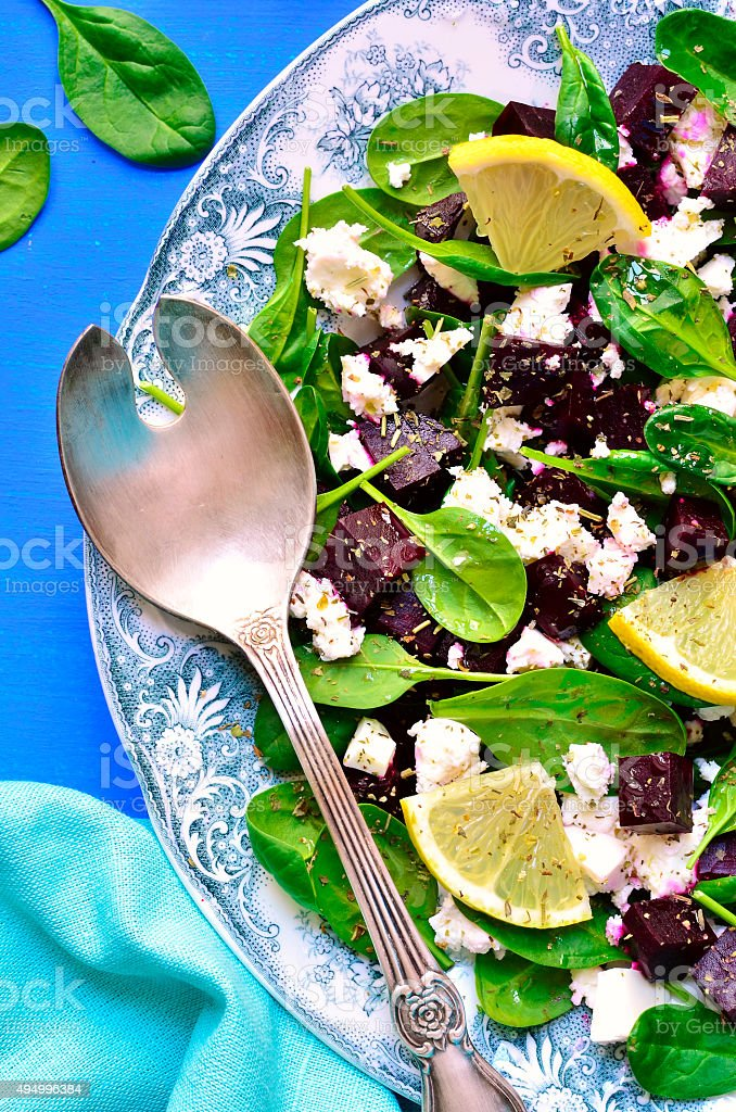 Spinach salad with beet root and feta cheese. stock photo