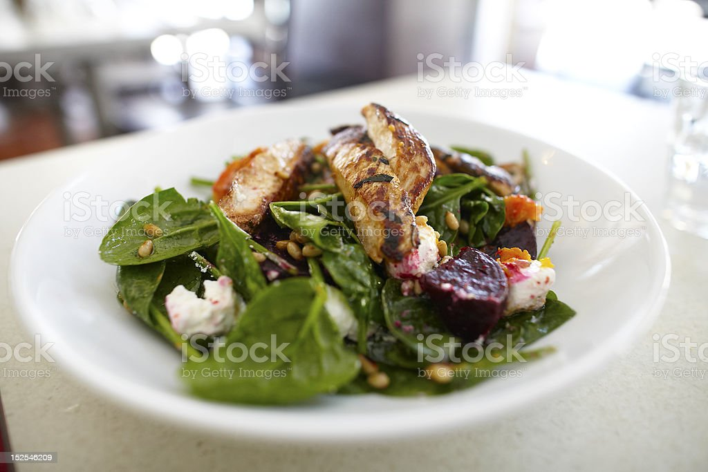Spinach salad with beetroot and grilled chicken royalty-free stock photo