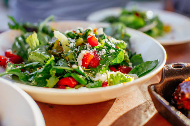 Spinach Salad with Strawberries, Goat Cheese, Balsamic, and Walnuts stock photo