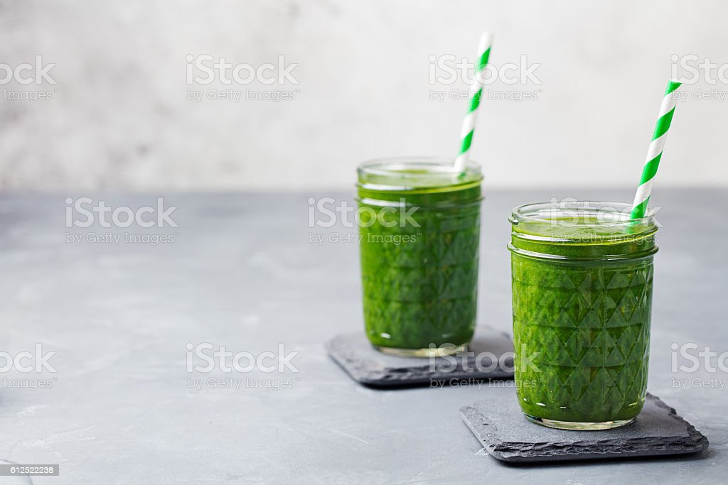 Spinach smoothie Healthy drink in glass jar. Copy space stock photo