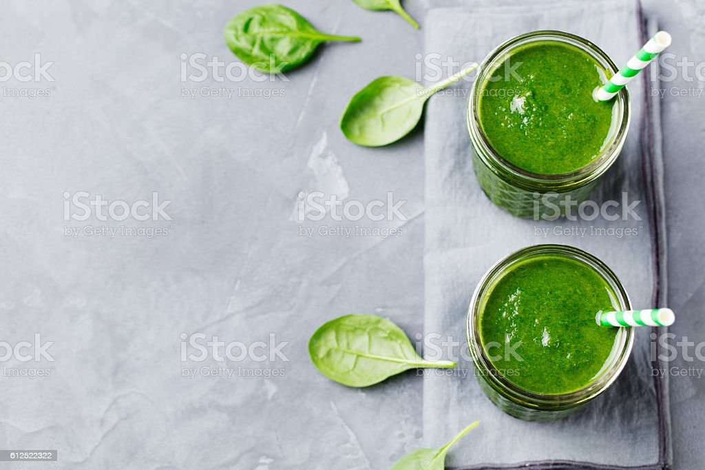 Spinach smoothie Healthy drink in glass jar. Top view stock photo