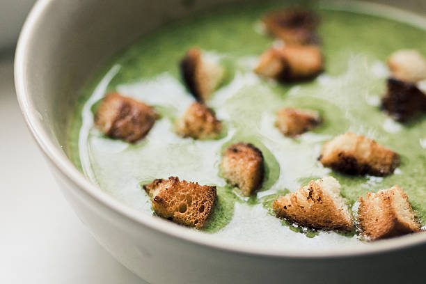 spinach soup with croutons stock photo