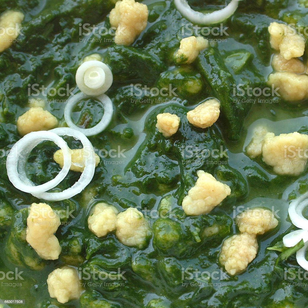 Spinach soup with fregola stock photo