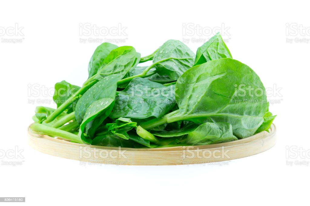 spinach vegetables isolated on white background stock photo