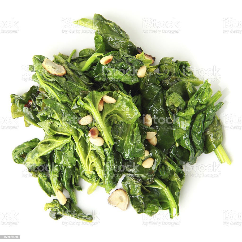 spinach with garlic and pine nuts stock photo