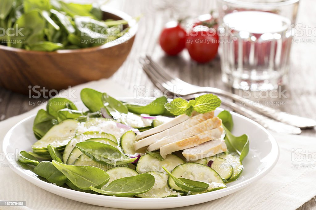 Spinach, zucchini and chicken salad royalty-free stock photo