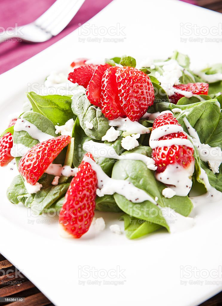 Spinach-Strawberry Salad with Lemon poppy-seed dressing. royalty-free stock photo