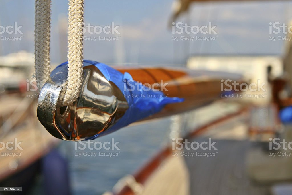 Spinakker Pole being varnished on classic yacht. royalty-free stock photo