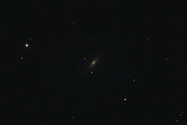 Spindle Galaxy Messier 102 The Spindle Galaxy Messier 102 in the constellation Draco photographed with a Maksutov telescope from Mannheim in Germany. lenticular cloud stock pictures, royalty-free photos & images