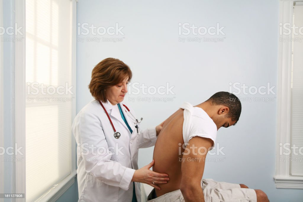 Spine and back exam royalty-free stock photo