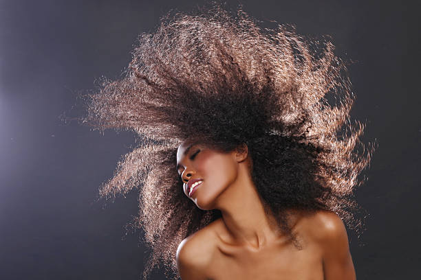 Spinning afroamericana mujer con grandes negro - foto de stock