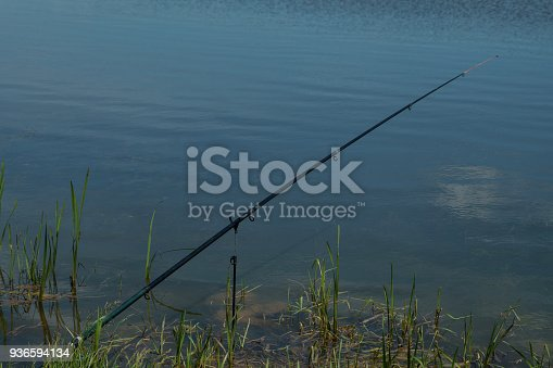 1094918172 istock photo spinning and reel on the summer lake 936594134