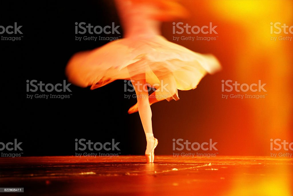 Spinning ballerina with motion blur during ballet performance stock photo