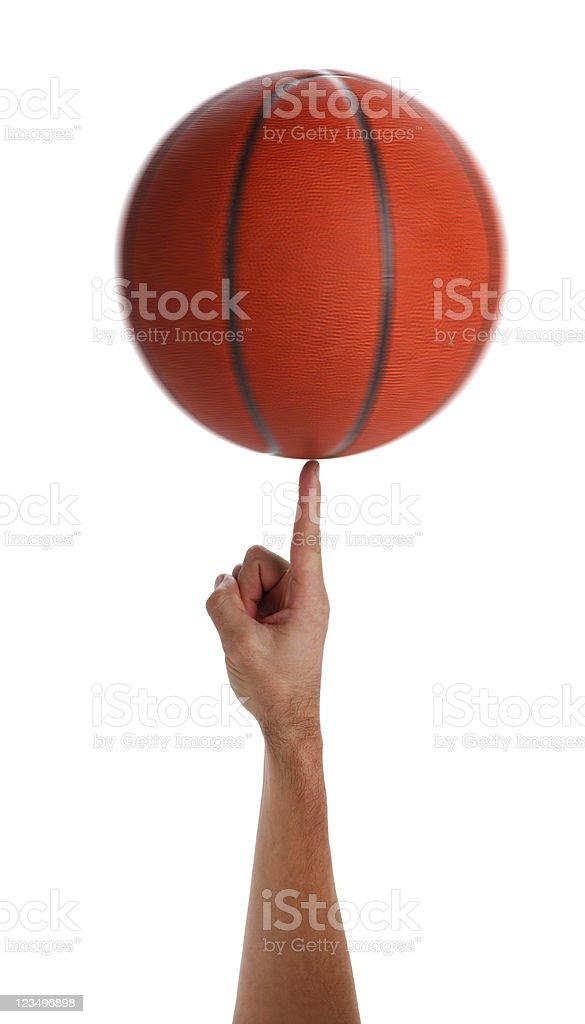 Spinning basketball on finger stock photo