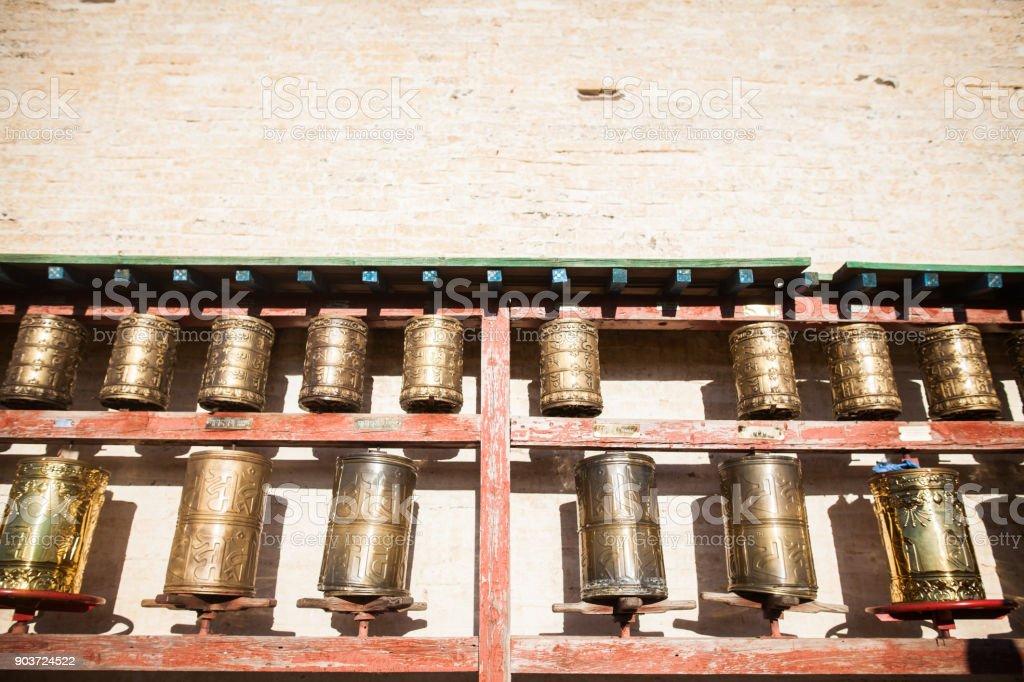 Spinning Buddhist prayer drums stock photo