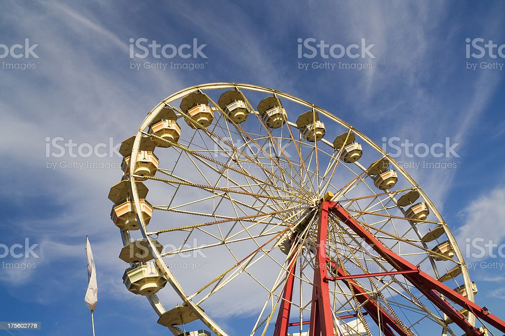 Spinning Ferris Wheel at Carnival Fair, Under Summer Sky Hz royalty-free stock photo