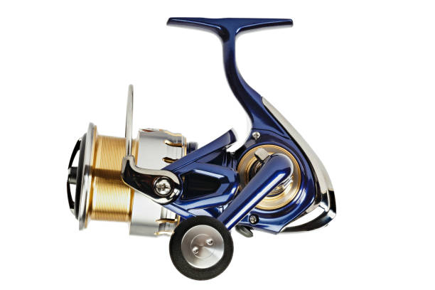 spinning fishing reel isolated on a white background. stock photo