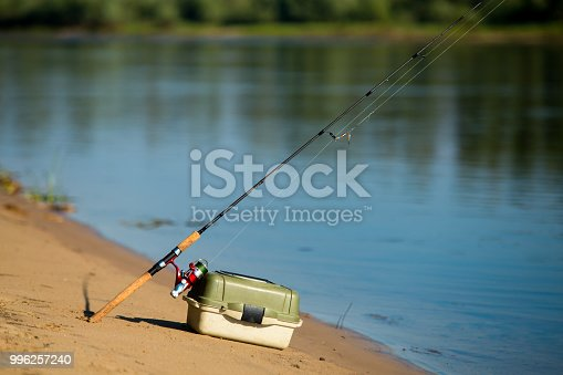 istock Spinning for fishing and box with fishing lures 996257240