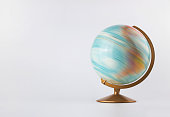istock Spinning globe model in motion isolated on white background 1204493796