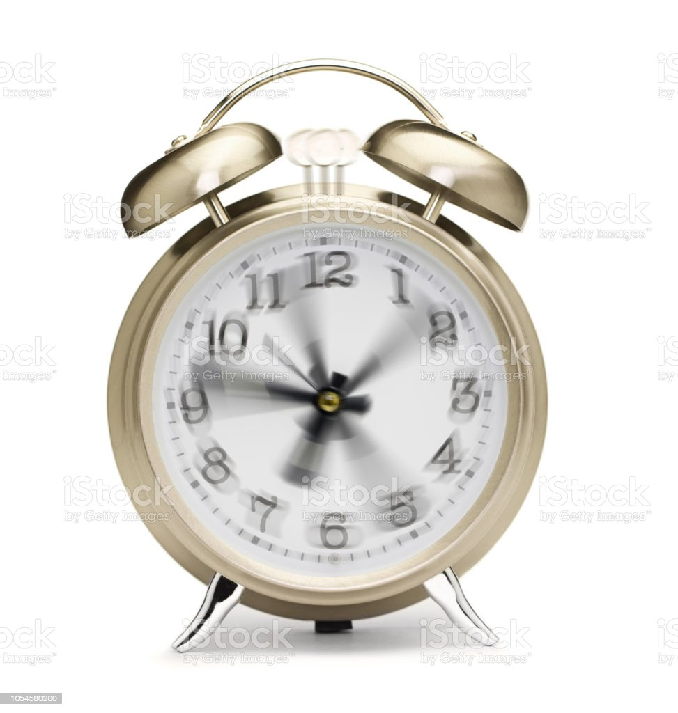 Spinning Hands On Vintage Alarm Clock On White Background Stock Photo -  Download Image Now