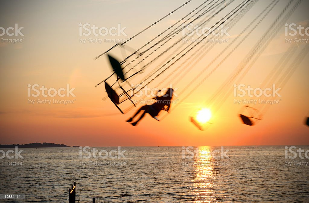 Spinning Marry-Go-Round At Sunset royalty-free stock photo