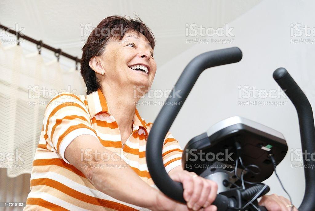 Spinning mature woman stock photo