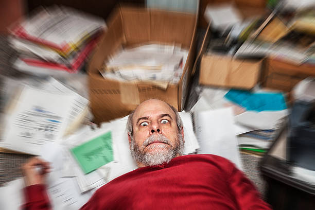 spinning office paper chaos panic business man - hoarding stock photos and pictures