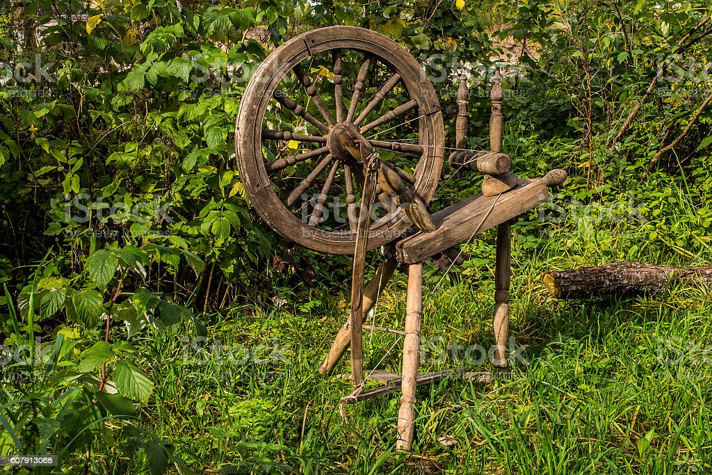 spinning wheel old-time stock photo