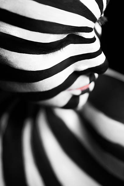 spiral bodyart on the body of a young girl - naked women with animals stock photos and pictures
