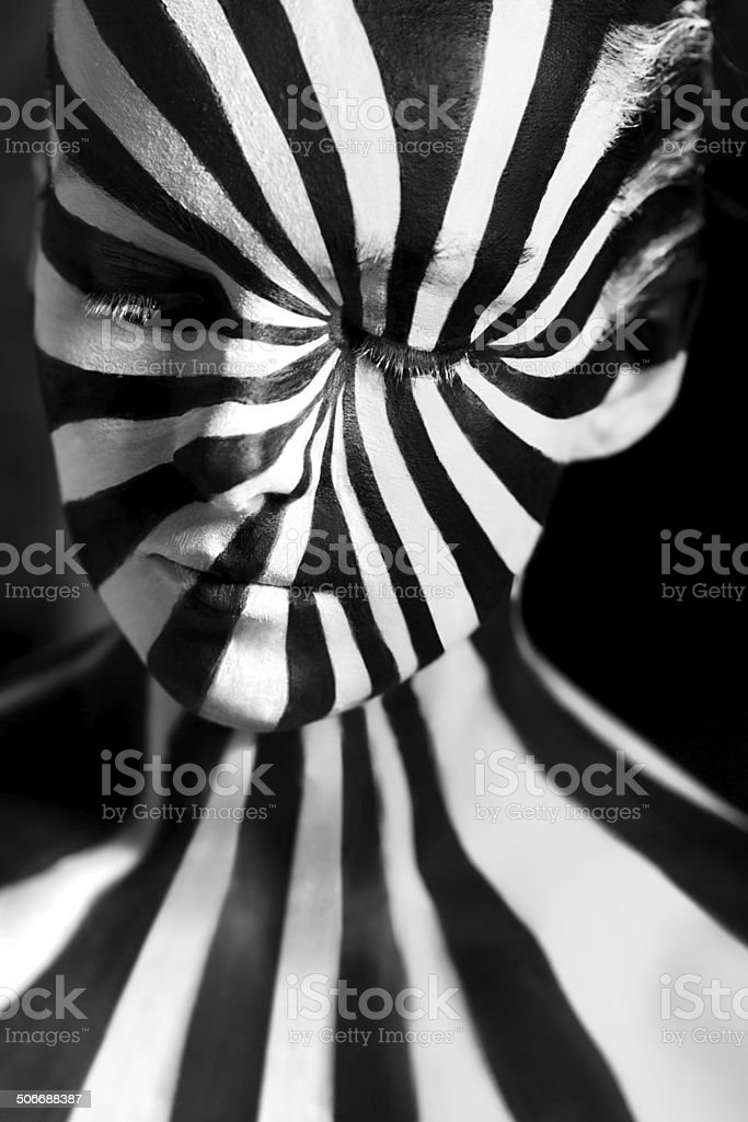 Spiral bodyart on the body of a young girl stock photo