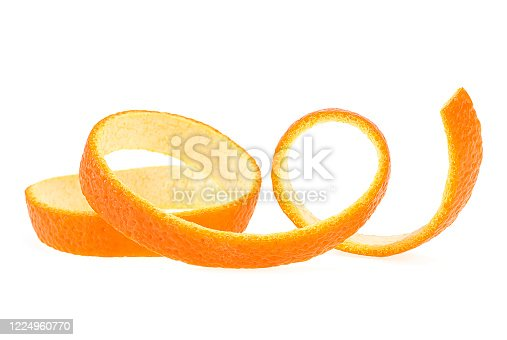 Spiral form of juicy orange skin isolated on a white background. Vitamin C.