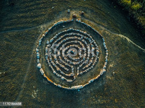 Spiral labyrinth made of stones, top view from drone.