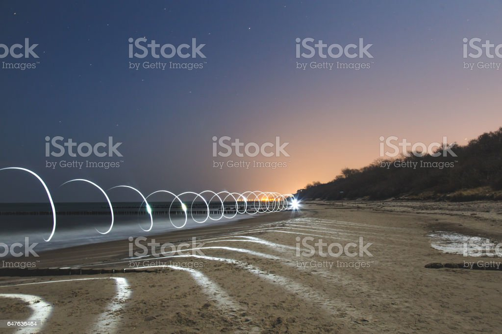 Spiral light lines trail at night stock photo